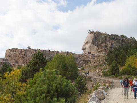 A 10-kilometer woodlands walk to see the Crazy Horse sculpture-carving process in progress