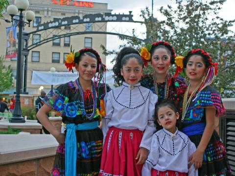 Dancers dressed in traditional garb for Cheyenne's Hispanic festival