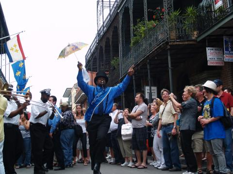 Live street music during a French Quarter Fest second line