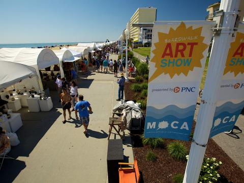 Strolling the Boardwalk Art Show on a cloudless day