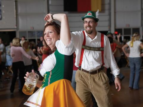 Dancing in traditional German outfits at Oktoberfest